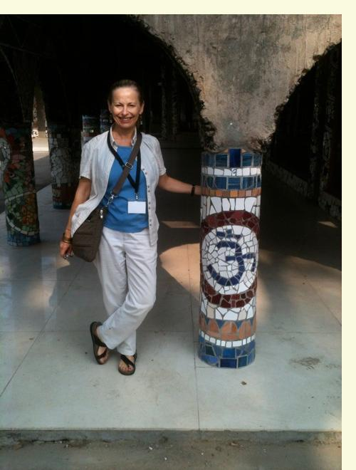 Cathy Amos with mosaic pillar in Phase 3 of Rock Garden